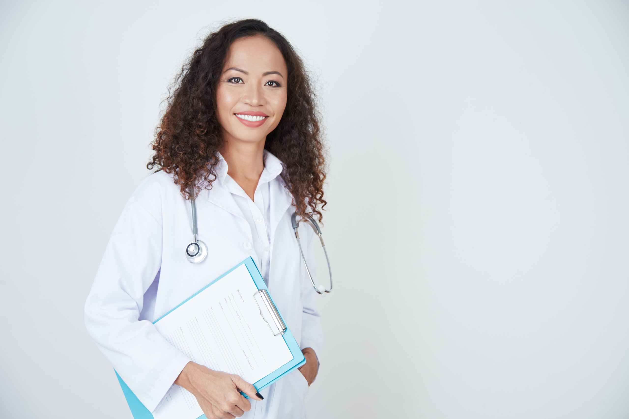 Doctor standing with health card